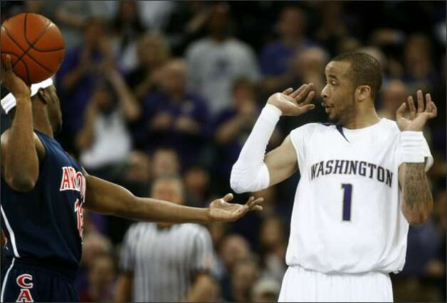 University of Washington player Venoy Overton reacts to University of Arizona player Nic Wise. Photo: Joshua Trujillo, Seattlepi.com