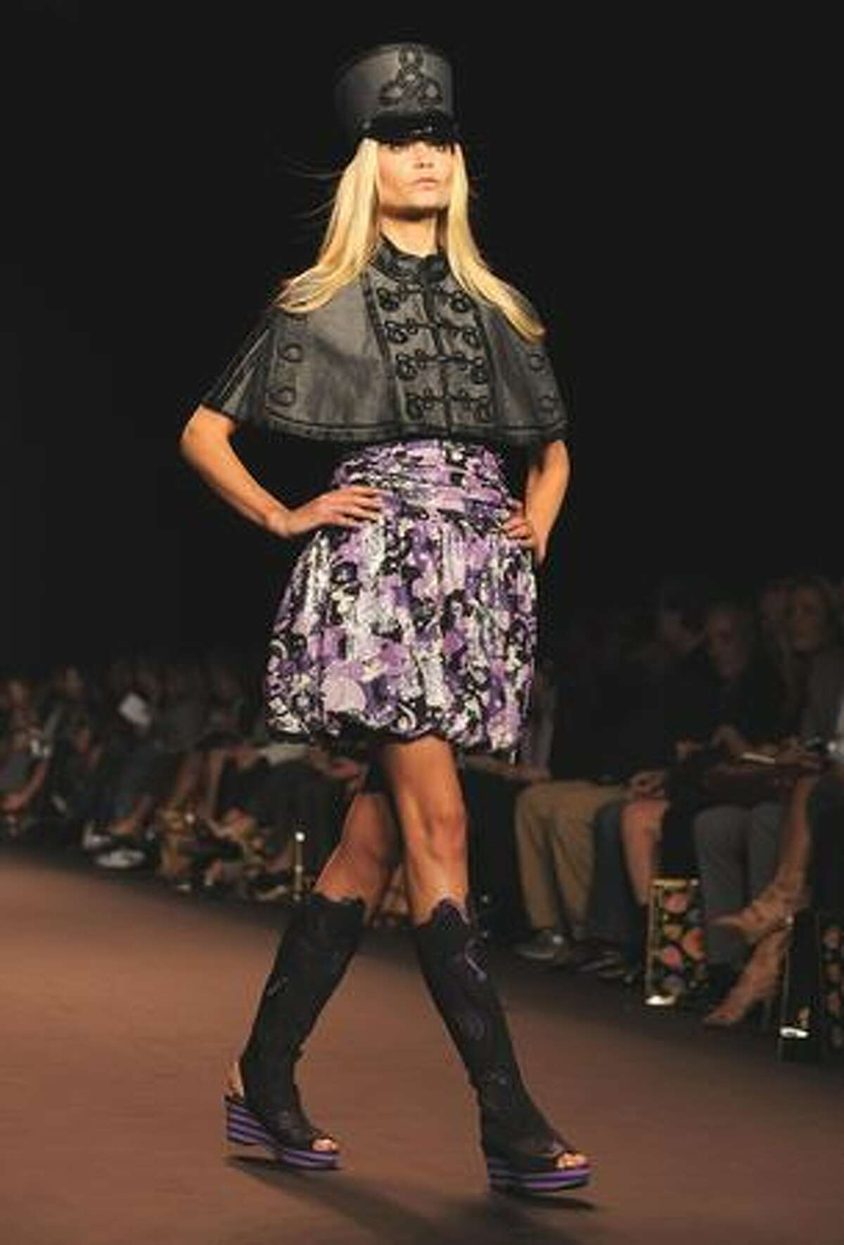 A model presents an outfit at the Anna Sui show during the spring 2010 Mercedes-Benz Fashion Week in New York on Wednesday, Sept. 16, 2009.