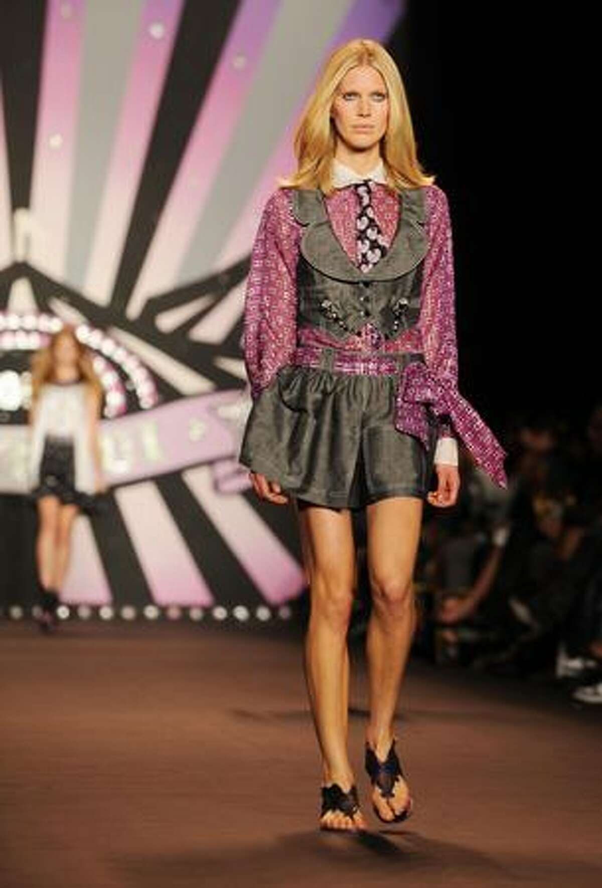 A model presents an outfit by Anna Sui.