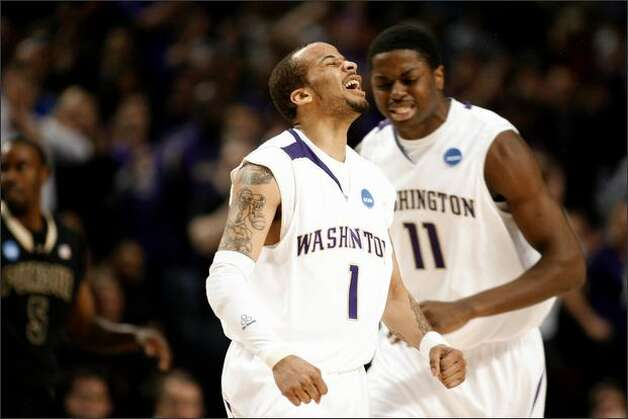 UW's Venoy Overton, right, and Matthew Bryan-Amaning react to a play. Photo: Clifford DesPeaux, Seattlepi.com