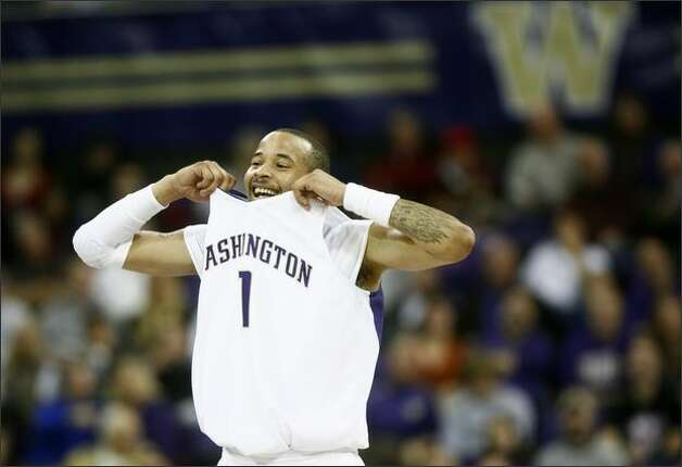 University of Washington player Venoy Overton was all smiles as the Huskies pull away from the University of Oregon. Photo: Joshua Trujillo, Seattlepi.com