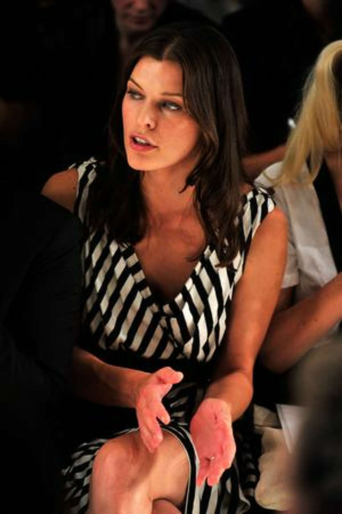 Actress Milla Jovovich attends Donna Karan Collection Spring 2010 fashion show at at 711 Greenwich Street in New York, New York.