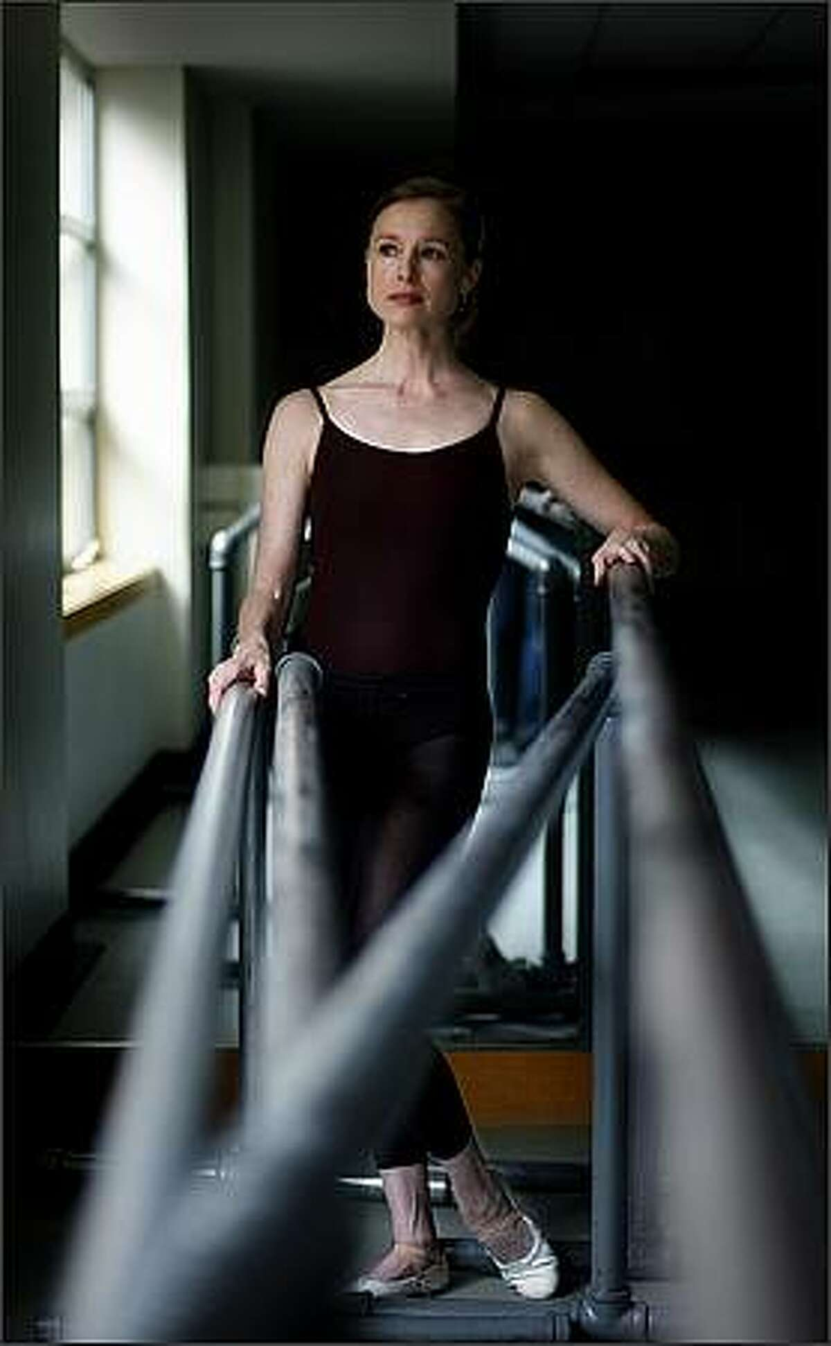 Louise Nadeau, a principal dancer with the Pacific Northwest Ballet, stands for a portrait in an empty studio at the Phelps Center in Seattle Tuesday, Jan. 13, 2009.