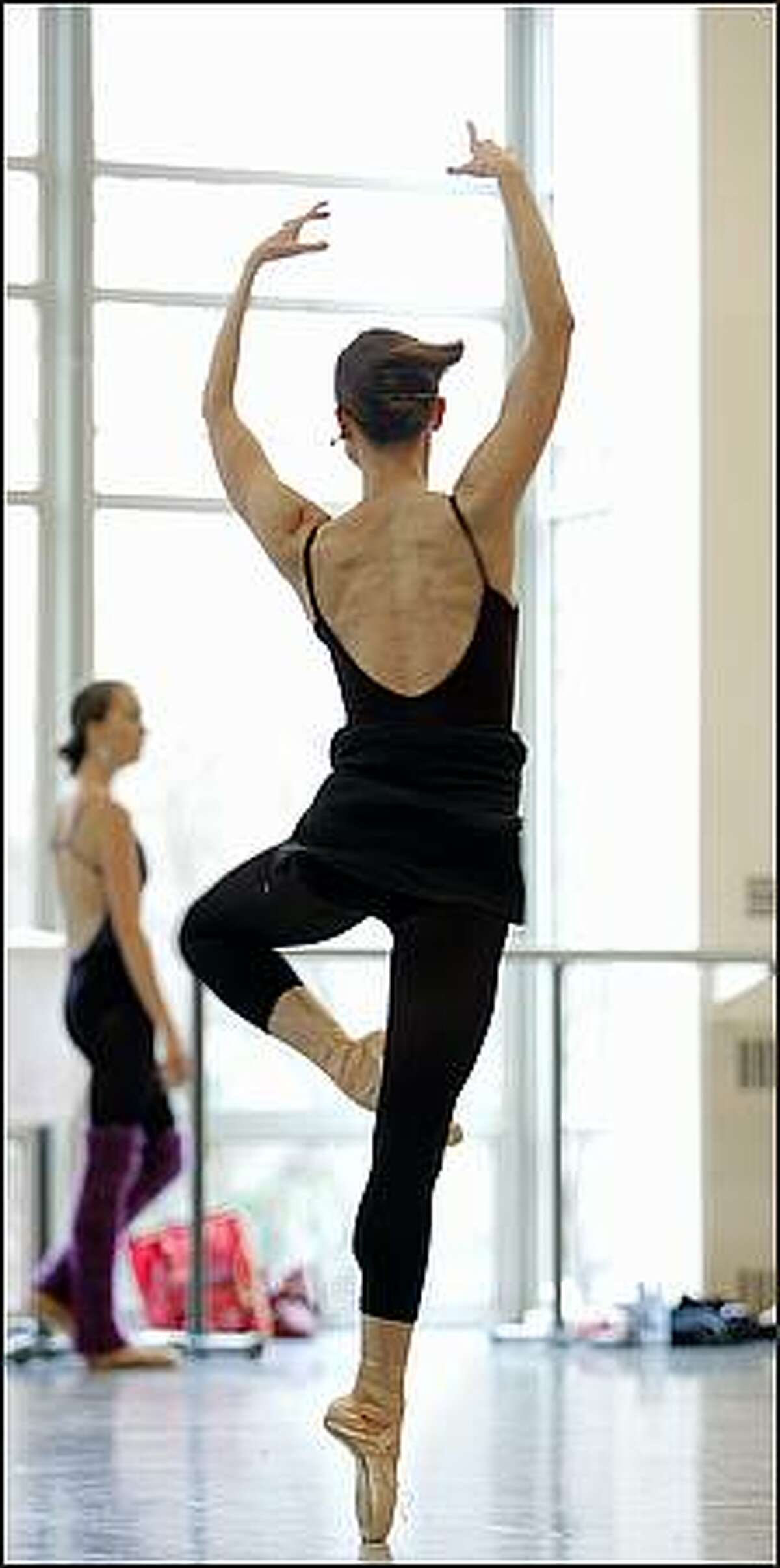 Louise Nadeau, a principal with the Pacific Northwest Ballet, participates in class with the rest of the company at the Phelps Center in Seattle Tuesday, Jan. 13, 2009.