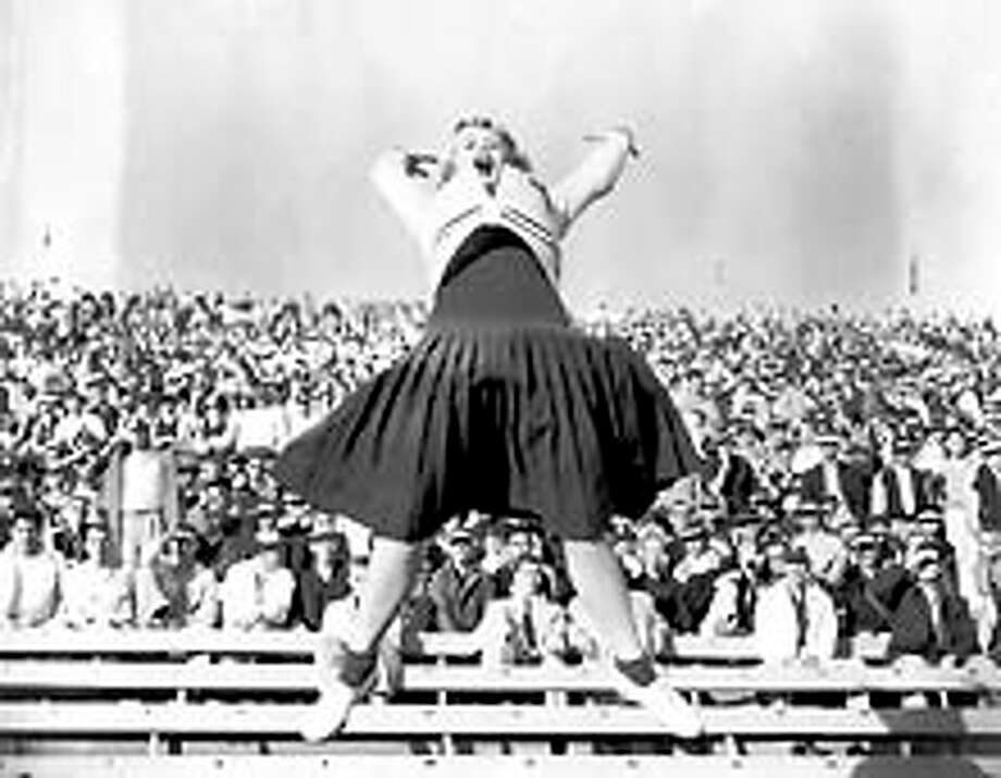 "Dorothy ""Dottie"" Provine, 19-year old University of Washington sophomore, had plenty to shout about during the first half of the Washington vs. Oregon game, as the Huskies led 7-6. October 31, 1954. She went on to become an actress, playing Pinky in the 60s TV show ""Roaring Twenties""