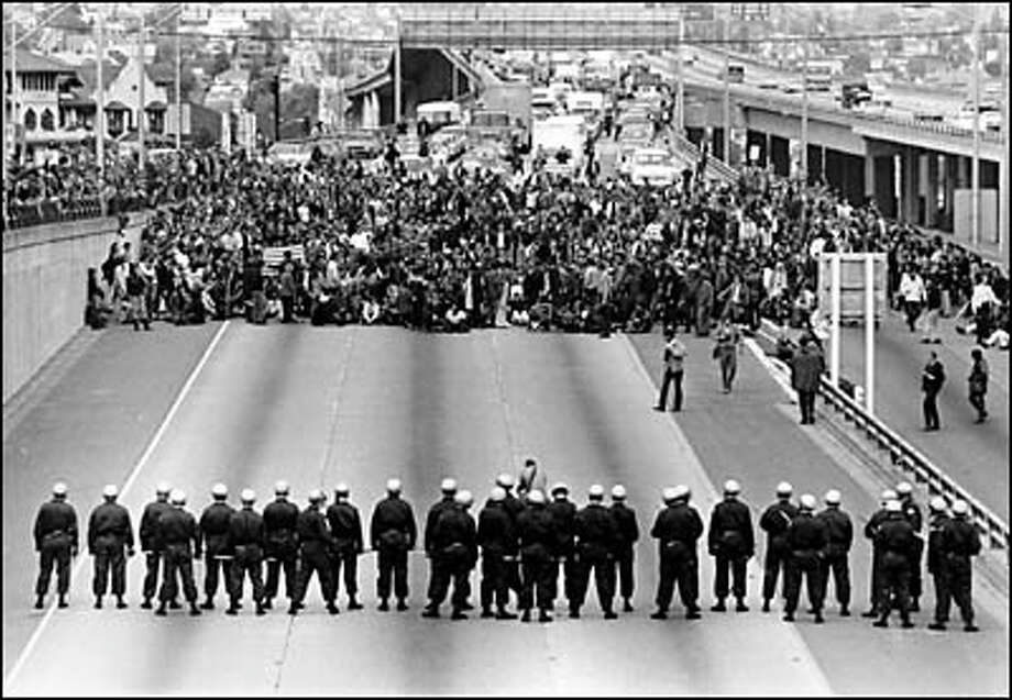 May 6, 1970, Thousands of protesting University of Washington students and faculty members blocked Interstate 5 for nearly an hour as they marched to a rally at the U.S. Courthouse. The crowd had gathered on campus to protest the killing of four Kent State students by National Guardsmen. Photo: Paul Thomas, Seattle Post-Intelligencer