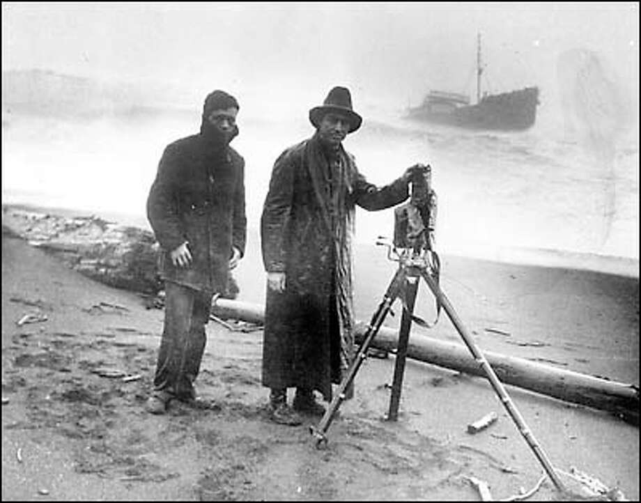 No date. Frank Jacobs and assistant at shipwreck. Photo: Seattle Post-Intelligencer