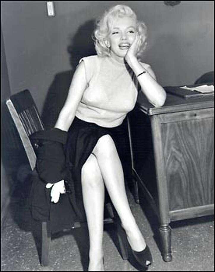 Even in a dingy office setting, Marilyn Monroe's legendary glamour shines through. Photo: Seattle Post-Intelligencer