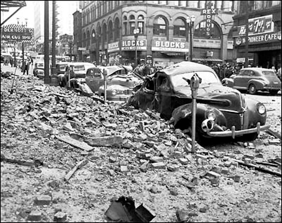 April 14, 1949. Shortly before noon an earthquake rocked the area from British Columbia to Oregon, causing extensive damage. P-I photographer Ken Harris rushed to Pioneer Square where he predicted damage would be extensive. Photo: Seattle Post-Intelligencer