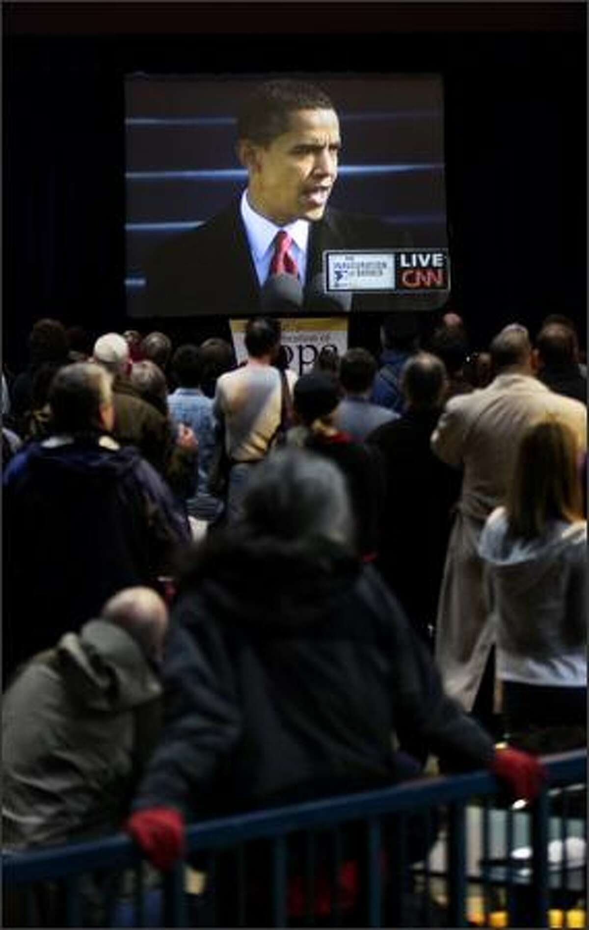 A crowd gathers at Center House at the Seattle Center to watch a live telecast of Barack Obama's inauguration ceremony.