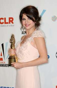 "Actress Selena Gomez poses in the press room with the Year in Televison Comedy Actress award for ""The Wizards of Waverly Place"" at the 2009 ALMA Awards held at Royce Hall in Los Angeles, California. Photo: Getty Images"