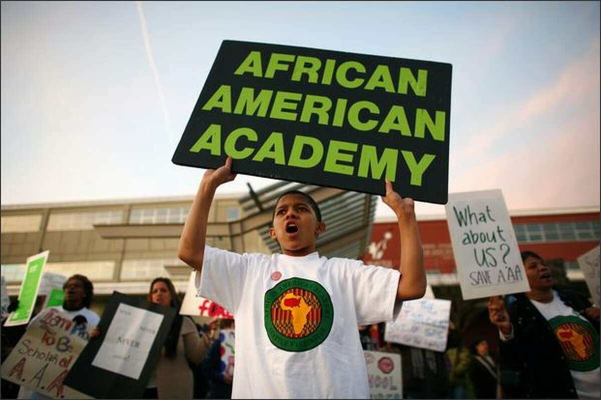 Maliiq Jackson, 13, a seventh grader at the African American Academy, joins other students and community members as they gather on Thursday at the John Stanford Center for Educational Excellence in Seattle before the final vote for school closures.