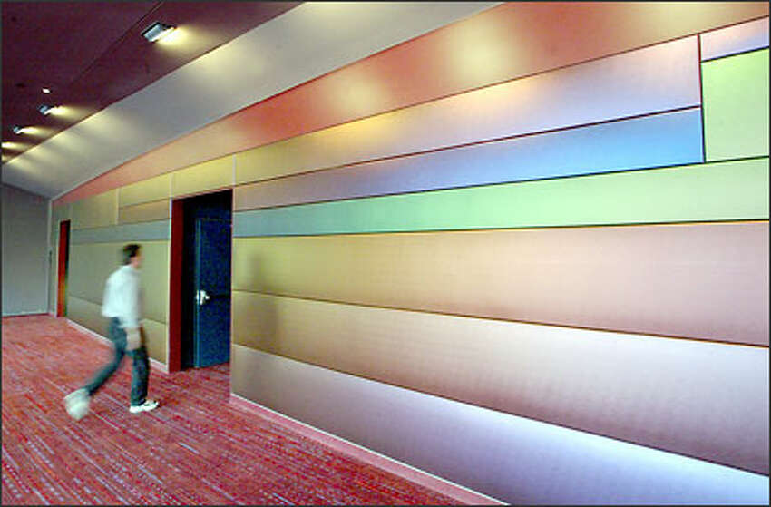 Magilite fabric, which changes colors with light and the angle at which it is viewed, covers the back walls of the upper lobbies.