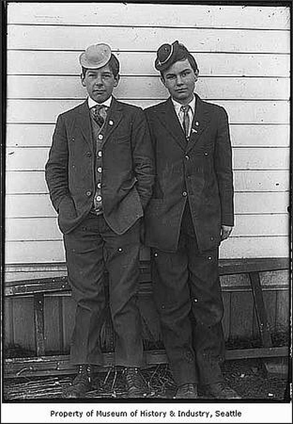 Boys wearing hats from the Alaska Yukon Pacific Exhibition in Seattle in 1909. (Carl Henry Moen/MOHAI)