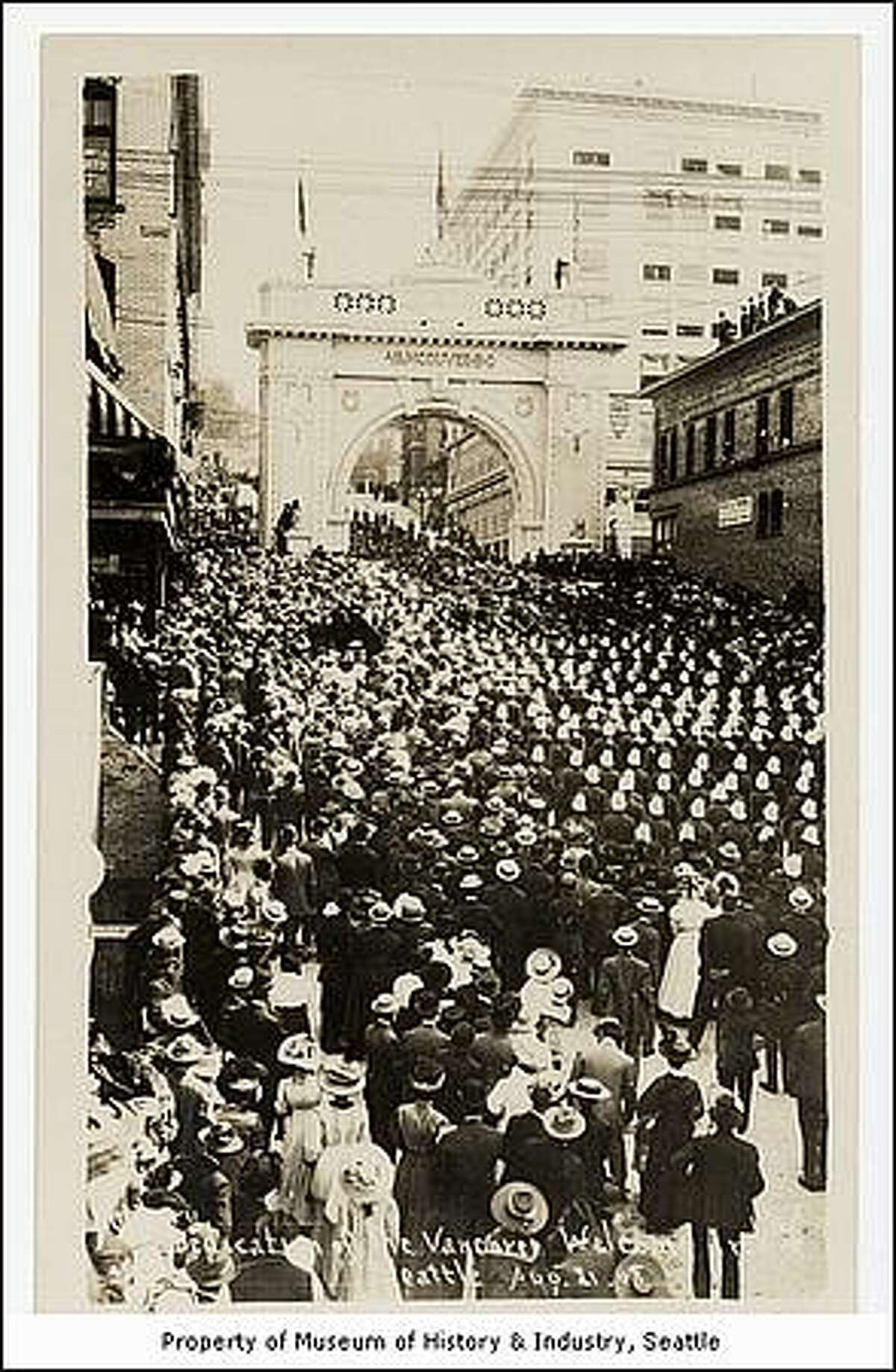 Dedication of the Vancouver Welcome Arch on Aug. 21, 1909, at the Alaska Yukon Pacific Exposition in Seattle. (Otto Daniel Goetze/MOHAI)