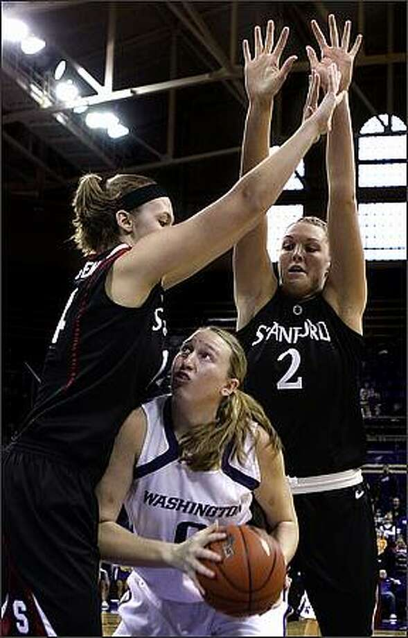 Washington's Laura McLellan looks for space to put up a shot against the defense of Stanford's Kayla Pedersen, left, and Jayne Appel. Photo: Andy Rogers, Seattle Post-Intelligencer