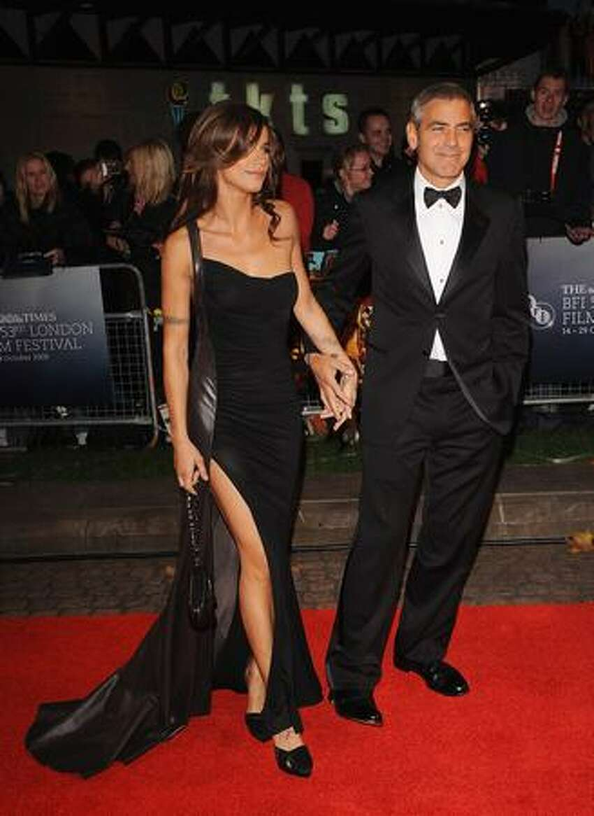 Actor George Clooney and girlfriend Elisabetta Canalis attend the world premiere of 'Fantastic Mr. Fox' and the opening gala of the Times BFI London Film Festival at the Odeon Leicester Square in London, England.