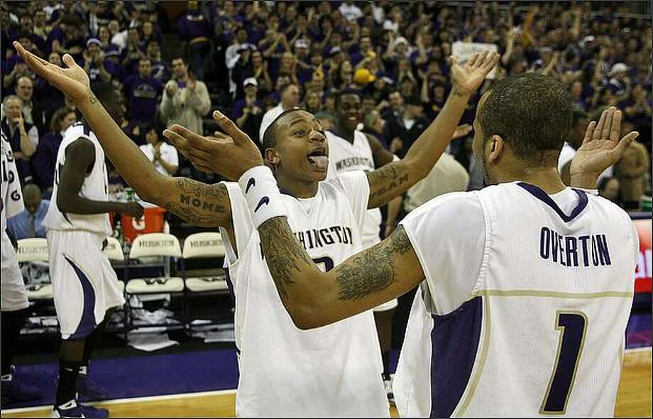 Washington Huskies Isaiah Thomas greets Venoy Overton after the Huskies 79-60 victory over the Oregon State Beavers during at the University of Washington. Photo: Mike Urban, Seattle Post-Intelligencer