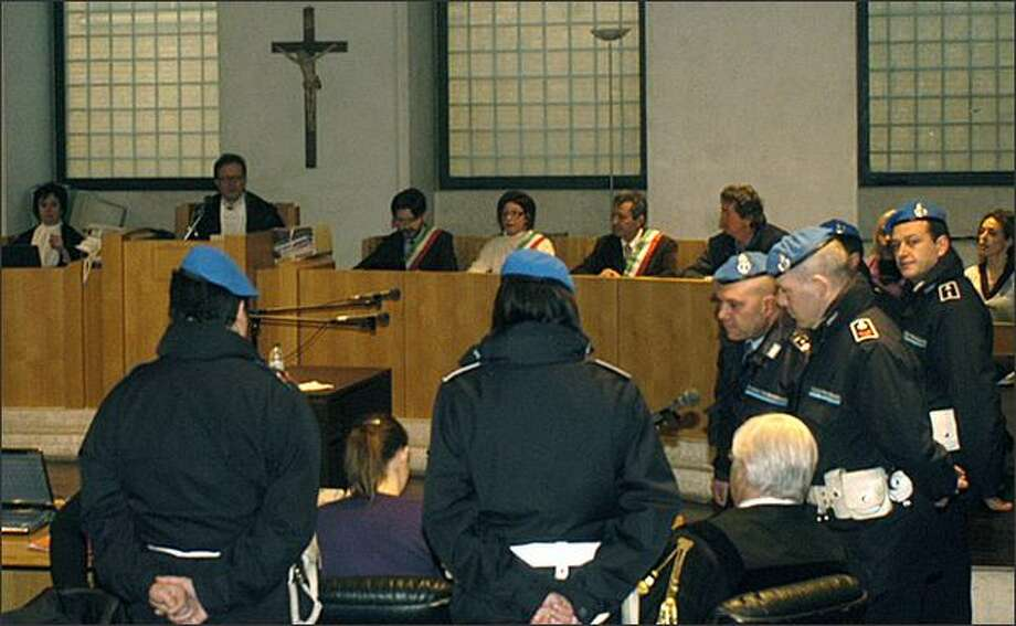 Sitting at center foreground with ponytail and back to camera, American murder suspect Amanda Knox stands trial with her former boyfriend Raffaele Sollecito (unseen), in Perugia, Italy, Saturday, Feb. 14, 2009. Sollecito and Knox are charged with murder and sexual violence in the slaying of British student Meredith Kercher, who was found stabbed to death Nov. 2, 2007 in the apartment she shared with Knox in Perugia. Knox and Sollecito deny any wrongdoing. (AP Photo/Stefano Medici) Photo: Associated Press