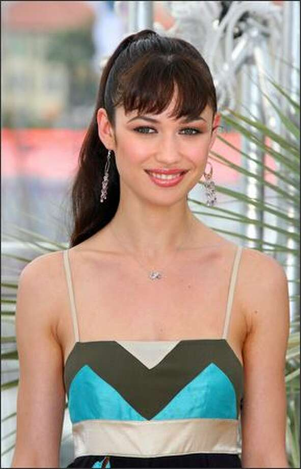 Ukrainian actress Olga Kurylenko poses during a photocall for the film 'Paris Je T'Aime' at the 59th edition of the International Cannes Film Festival in Cannes, Southern France, 18 May 2006. Competition gets underway in earnest at the Cannes Film Festival 18 May with films stoking controversy for their focus on pivotal political events fuelled by youthful dreams of freedom. Photo: Getty Images