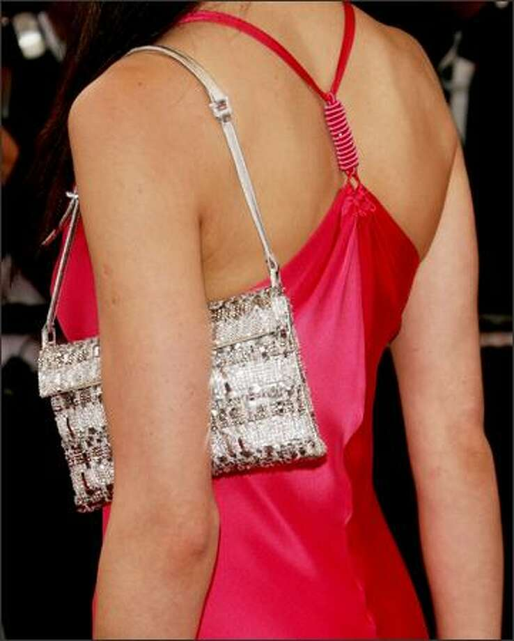 Actress Olga Kurylenko attends the 'Paris Je T'aime' premiere during the 59th International Cannes Film Festival on May 18, 2006 in Cannes, France. Photo: Getty Images