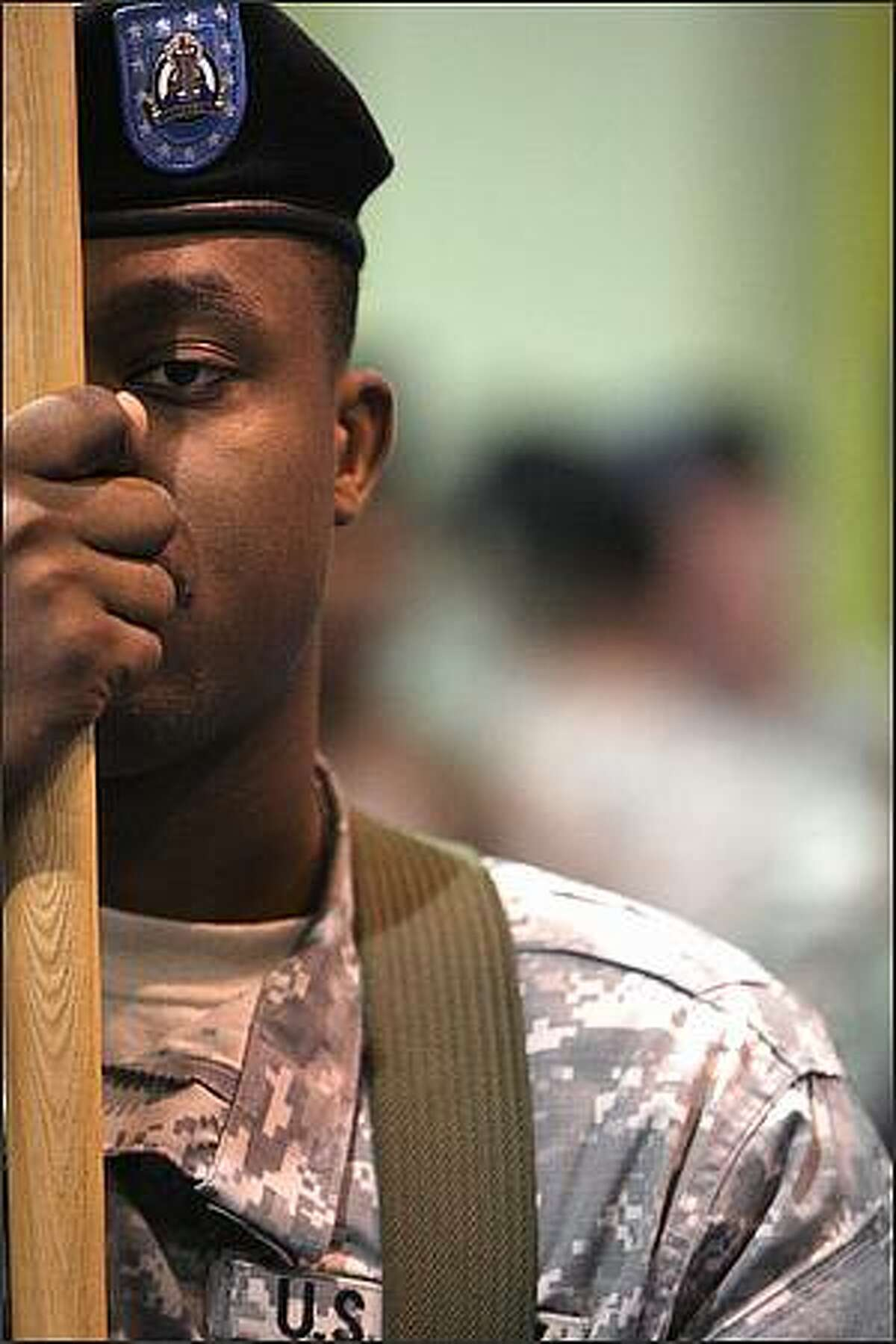 Sgt. Dakarai Davis participates in the I Corps Headquarters unit deployment ceremony at Fort Lewis in preparation for its deployment to Iraq.