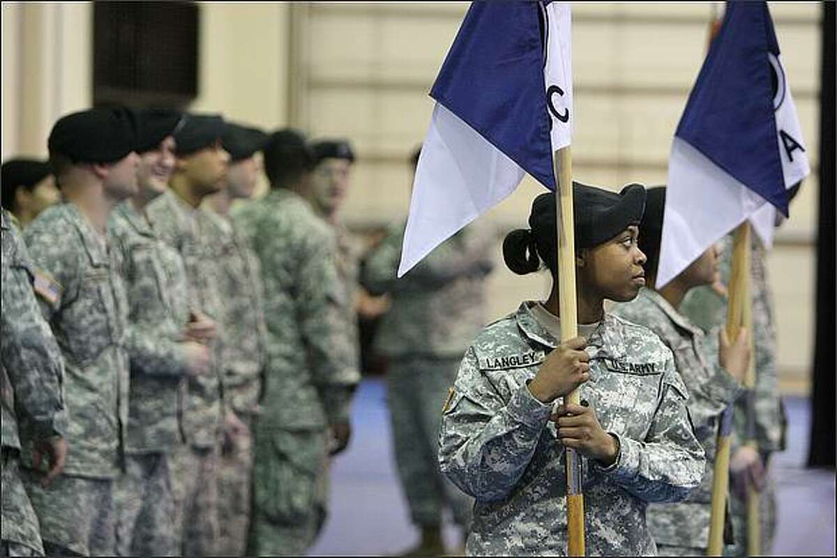 E4 specialist Kiada Langley of Greenville, N.C., participates in the I Corps Headquarters unit deployment ceremony at Fort Lewis in preparation for its deployment to Iraq.