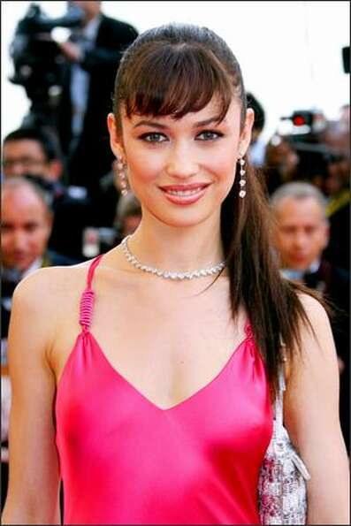 Ukrainian actress Olga Kurylenko poses upon arriving at the Festival Palace for the screening of the