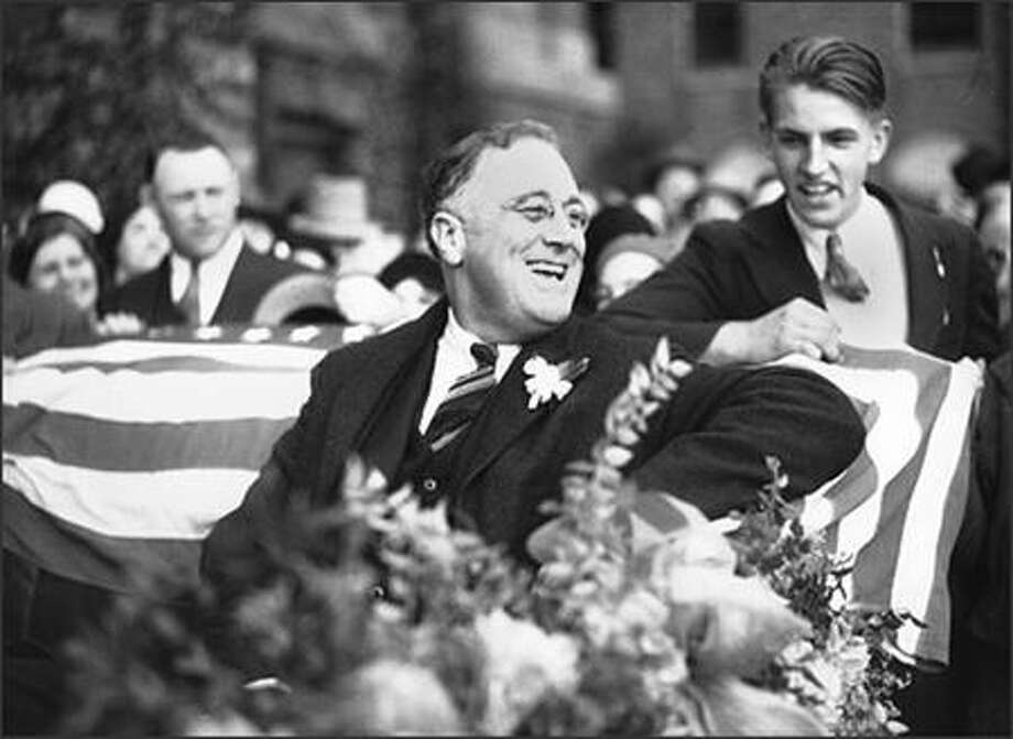 Just before his election as president of the United States, New York Gov. Franklin Delano Roosevelt visited Seattle in 1932. He flashed his famous smile from an open touring car, surrounded by an admiring crowd. The governor, born in 1882, and stricken with polio in 1921, would be elected to a record four terms as president, serving until his death in 1945. Photo: Museum Of History And Industry