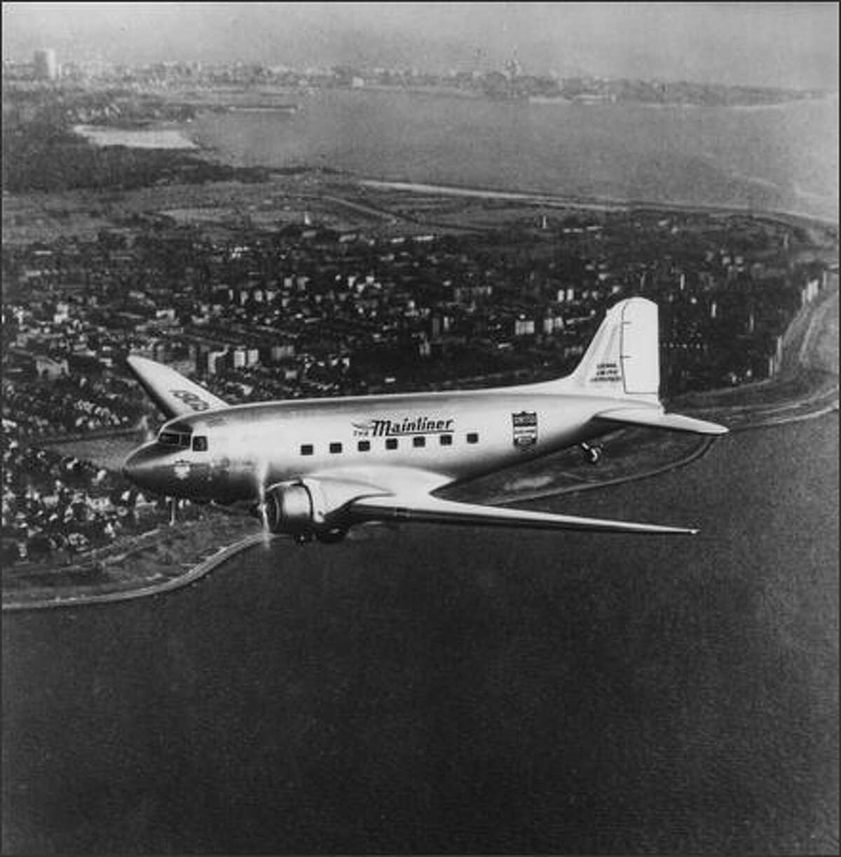 A new Douglas-built United Mainliner airplane in flight, 1937. A United ad that year boasted