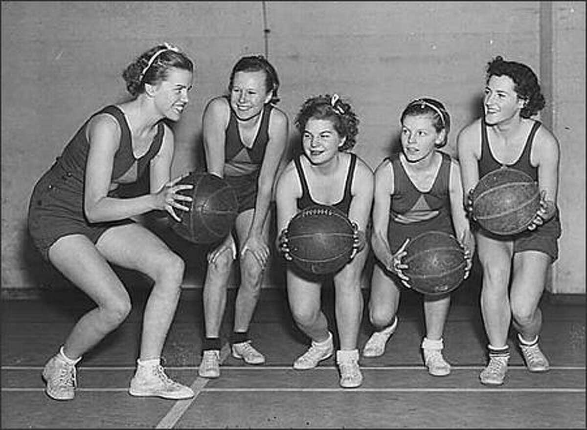 Basketball team, probably in Seattle, 1937. Handwritten on negative: Eitel - Johansen - Glad; Jorgenson - Volk.