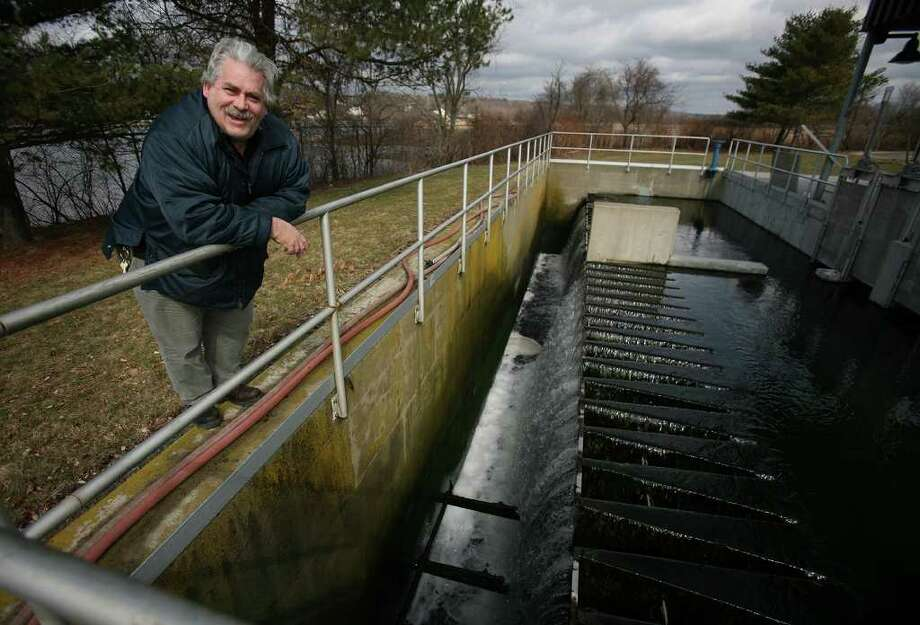 Wastewater Superintendent Jim Cooper shows the final stage in the water treatment process at the Housatonic Wastewater Treatment Facility in Milford recently. Photo: Brian A. Pounds / Connecticut Post