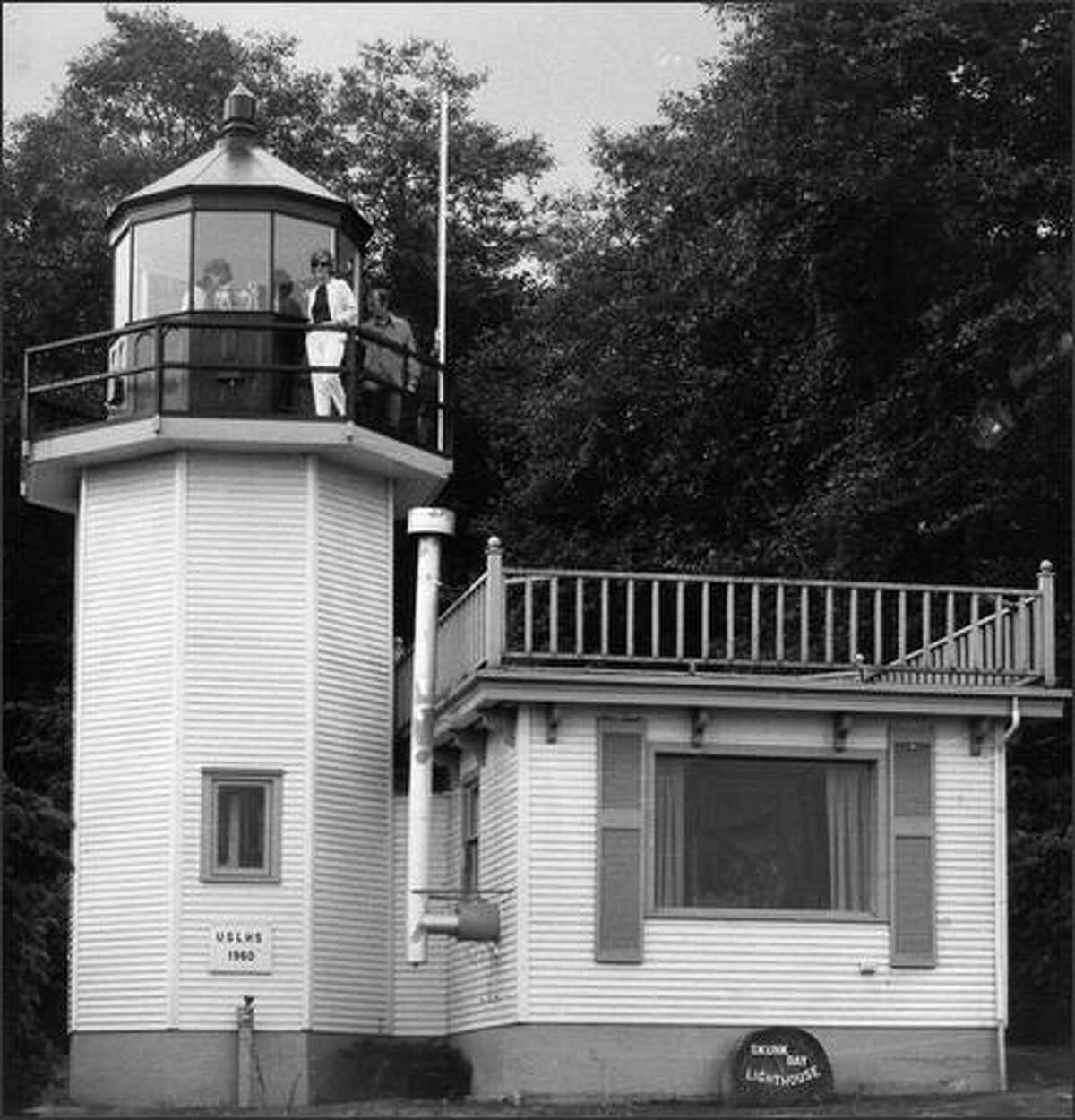 Skunk Bay Lighthouse is inspected by some of the new owners in September, 1970. (Seattle Post-Intelligencer)