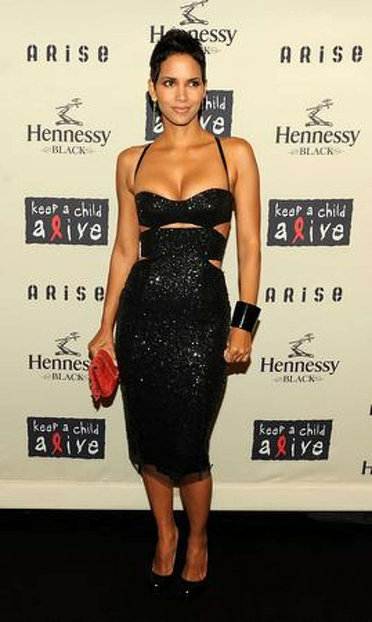 October 2009: Wearing Kaufman Franco at Keep A Child Alive's Black Ball in New York. Many thanks to Red Carpet Fashion Awards for help identifying the designers.