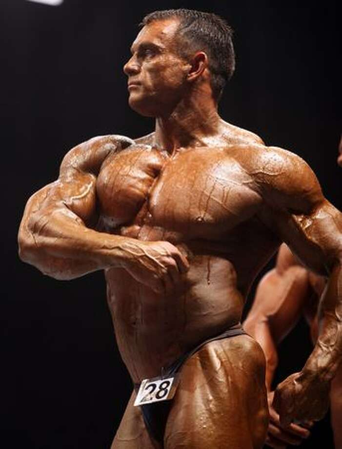 Bodybuilders pose for judges in the preliminary rounds of The Mister Universe competition at The Southport Theatre Saturday in Southport, England. Bodybuilders from all over the world are competiting for the National Amateur Body Building Association titles with their sculptured and honed bodies. Photo: Getty Images