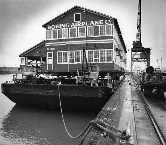 "Boeing's original ""Red Barn"" is loaded aboard a Foss barge on Dec. 16, 1975 for a trip down the Duwamish from Terminal 115 to the Museum of Flight, at Boeing Field. (Cary Tolman/seattlepi.com file) Photo: Museum Of History And Industry"