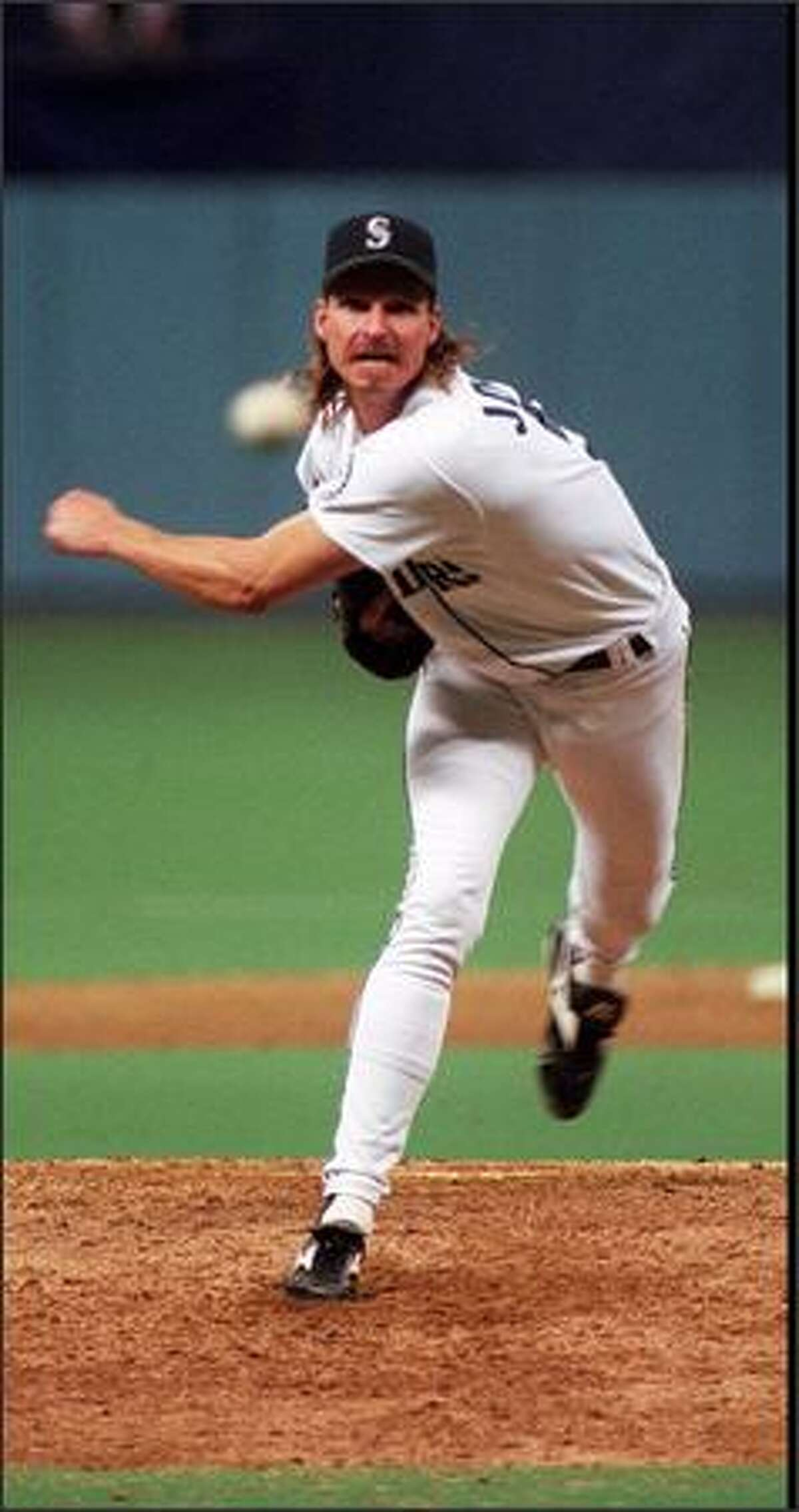 Mariners Randy Johnson delivers a pitch in the October 2, 1995 playoff game to decide AL West championship.
