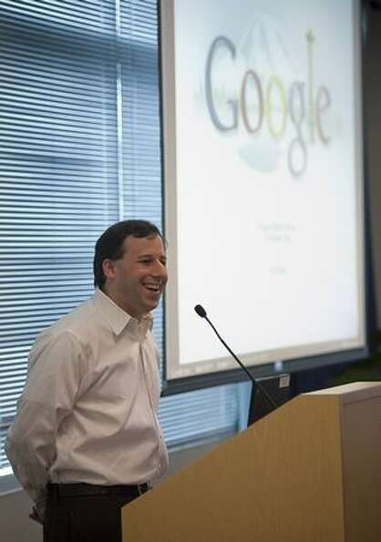 Scott Silver, engineering and site director for Google Kirkland, speaks during the grand opening of