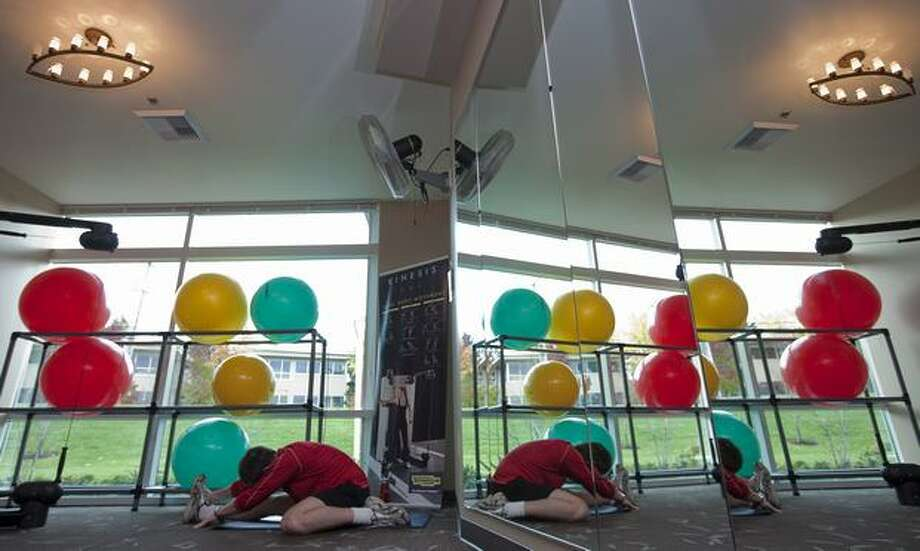A Google employee stretches out in the gym at Google Kirkland on Wednesday. Photo: Getty Images