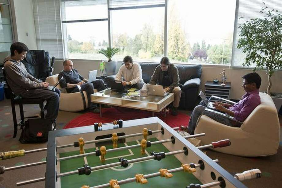 From left: Google software engineers Keith Ito, Nicholas Lee, John Leen and Yatin Chawathe work in a room with a view and a foosball table at the newly opened Google Kirkland offices on Wednesday. Photo: Getty Images