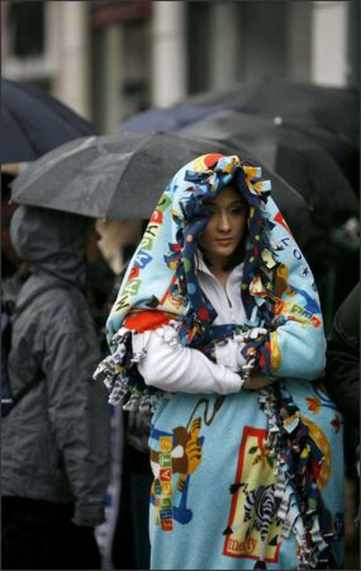 Jordan Assink from Bellingham waits in the rain.