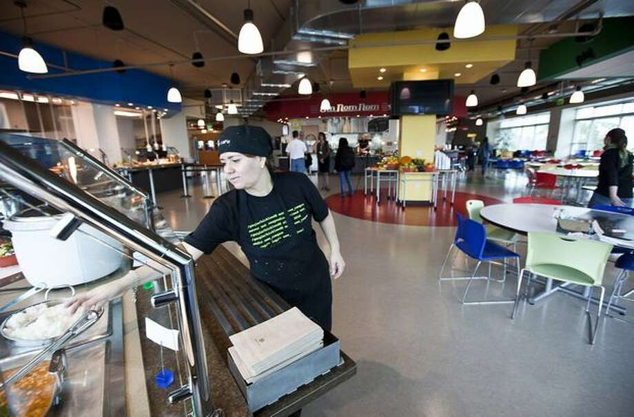 Marali Arrieta Yanez prepares for the lunch crowd in the cafe at Google Kirkland on Wednesday. Photo: Getty Images