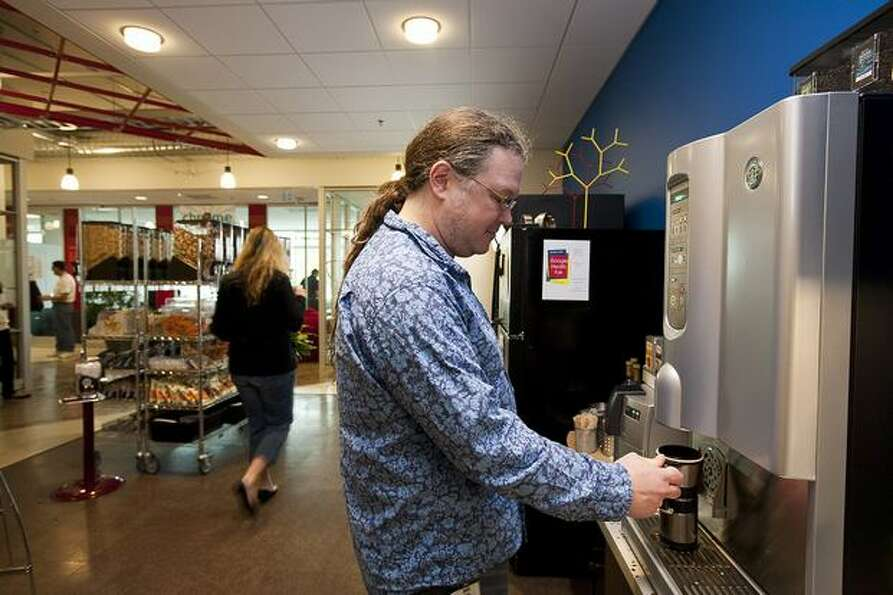 Google software engineer Steve Lacey gets a cup of coffee in a mini-kitchen at Google Kirkland on We