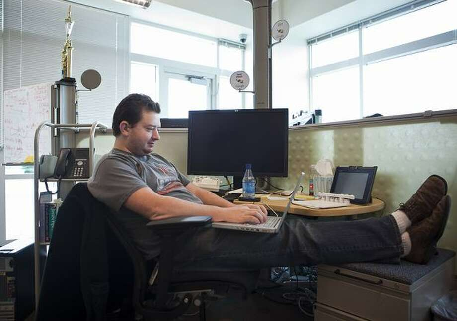 Google software engineer Greg Millam works at his desk at Google Kirkland on Wednesday. Photo: Getty Images
