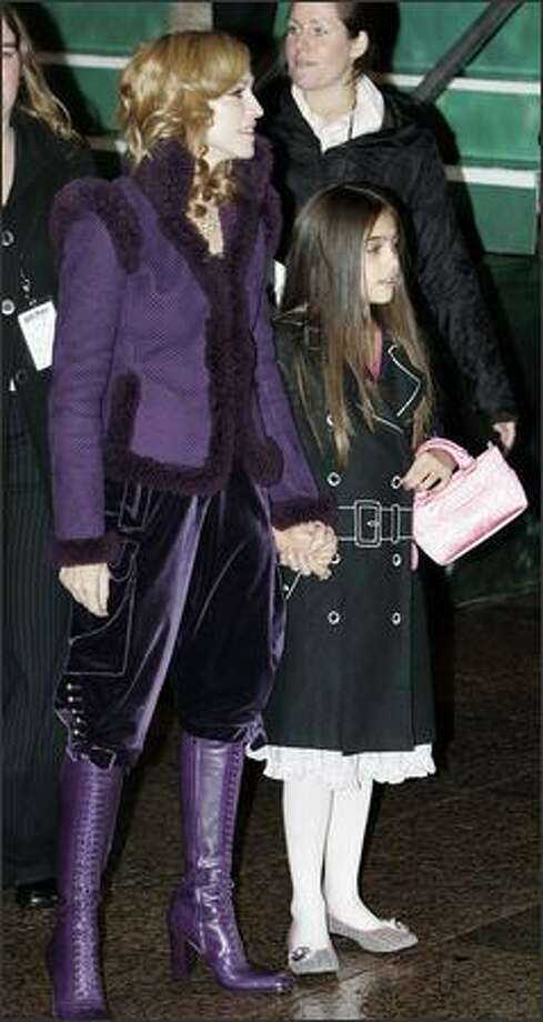 "U.S. pop star Madonna and her daughter Lourdes arrive at the world premiere of ""Harry Potter and the Goblet of Fire"" at Leicester Square, London, November 6, 2005. Photo: Reuters"