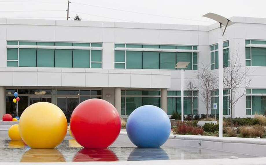 Exercise balls float in a fountain on the grounds of the new Google Kirkland facility on Wednesday. Photo: Getty Images