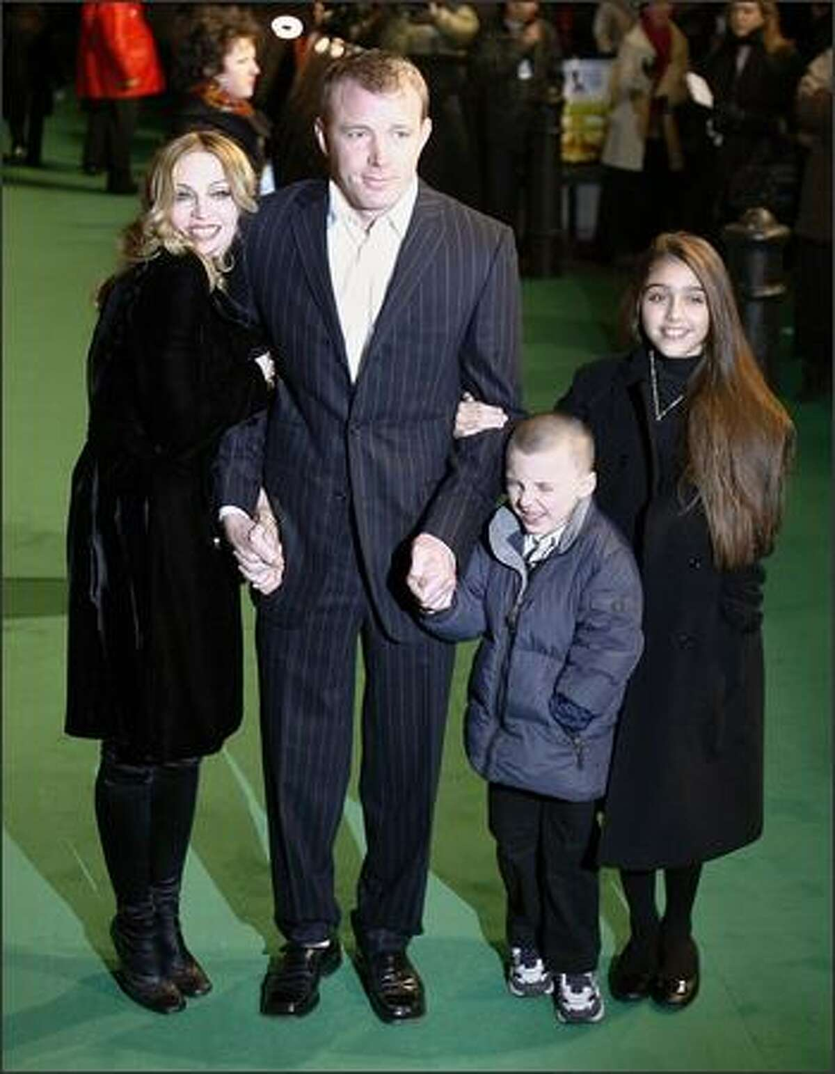 Madonna and then-husband Guy Ritchie stand with their children Rocco and Lourdes as they attend the premiere of the film