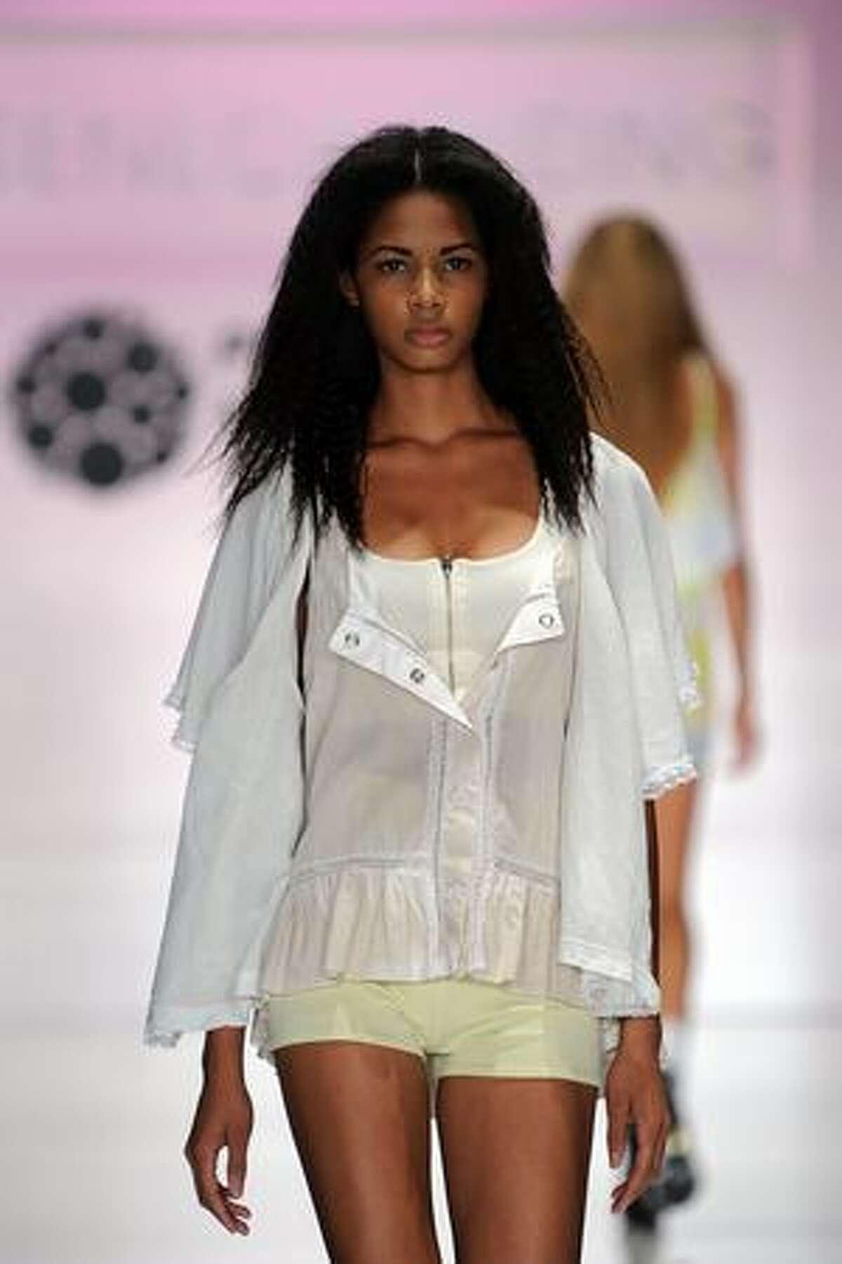 A model wears Seneca Rising on the runway at Gen Art's 12th Annual
