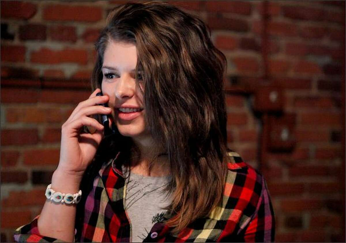 Elaine Easton calls a friend after auditioning at the MTV Real World casting call at Fuel Sports Eats and Beats in Seattle on Saturday.