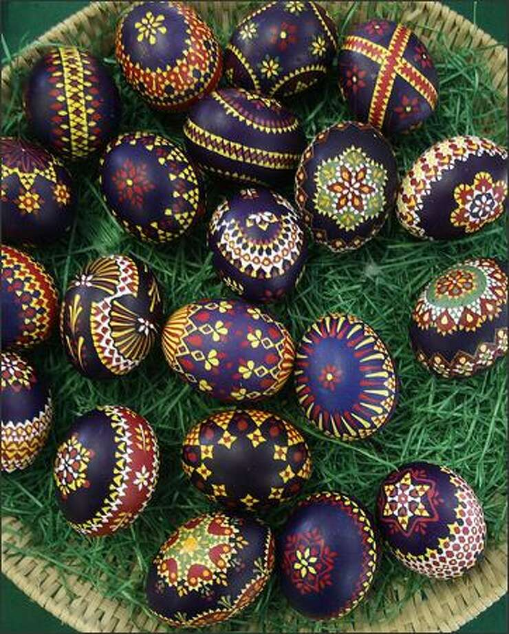 Traditionally hand-painted Easter eggs are on display for sale in the eastern German village of Schleife. A goose feather is used to decorate the eggs with wax, which are then dipped into colored dye several times in this traditional painting method by members of the Slavic ethnic minority community of Sorbs. Each color that is applied takes one hour. Photo: Reuters